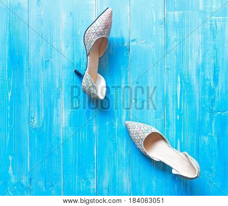Collection of women's shoes on blue background