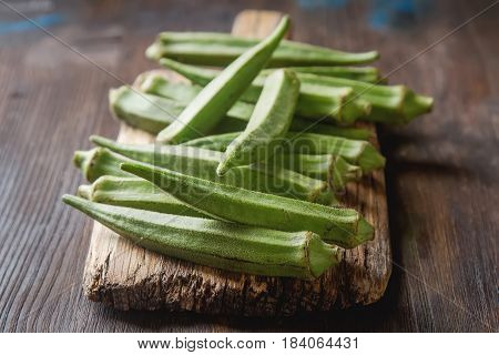 Lady Fingers Or Okra Over Wooden Table Background. ..