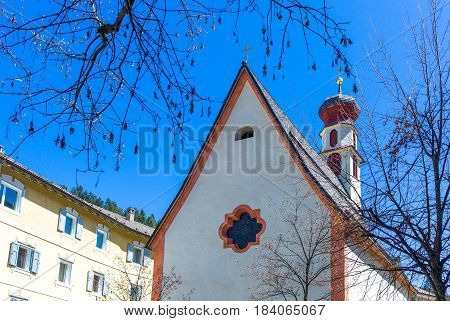Italy Dolomites Trentino Alto Adige Ortisei the parish church in the historic town center