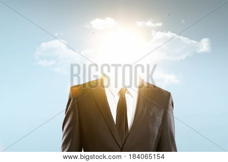 The head of the businessman is covered with sun and clouds business concept .