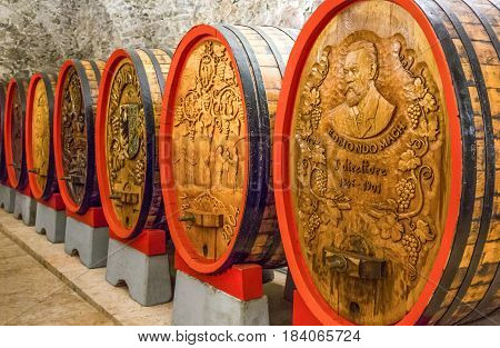 San Michele All'Adige Italy - June 28 2012: Fondazione Edmund Mach the historic cellars of the Agostiniana Abbey with decorated oak barrels