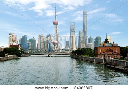 Shanghai skyline with historical Waibaidu bridge in Shanghai China. Shanghai luajiazui finance and business district
