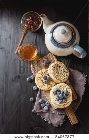 Hot Home Made Toasted Crumpets Served With Honey, Blueberry. Dar
