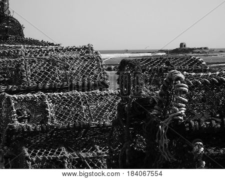 Lobster pots stacked in Seahouses harbor, Northumberland