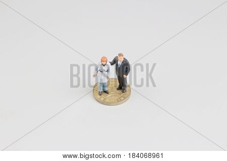 The Business Man On The Top Of Coins Stack
