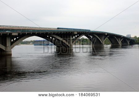 KIEV, UKRAINE - MAY 3, 2011: It is a two-tiered Metro Bridge across the Dnieper River.