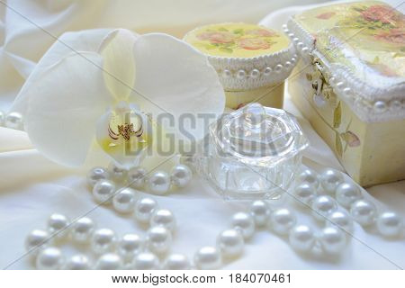 box with decorations, beads and Orchid flower