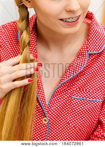 Woman Doing Braid On Blonde Hair