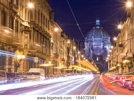 Brussels (Bruxelles) - February 2016, Belgium: Nigh view of the Belgian Capital, car light trails on Rue Royal street, view on Saint Mary's Royal Church