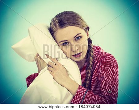 Young Woman Wearing Pajamas Hugging Soft Pillow