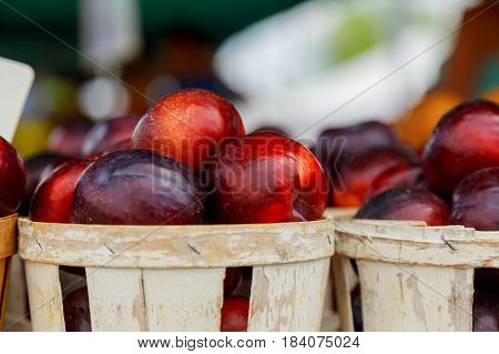 Farmer's Market Selling Plums
