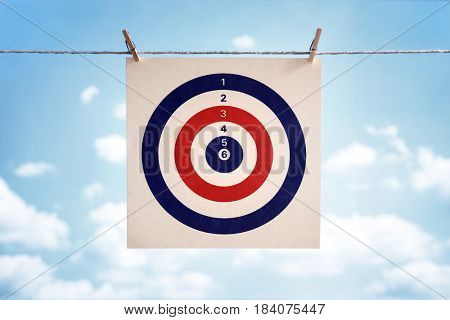 Target icon hanging from a clothesline concept for business strategy, goal or  bullseye