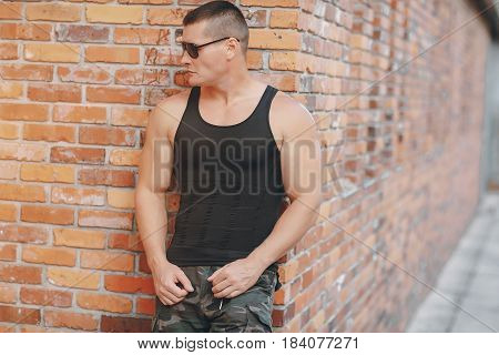 people on the background of a brick wall