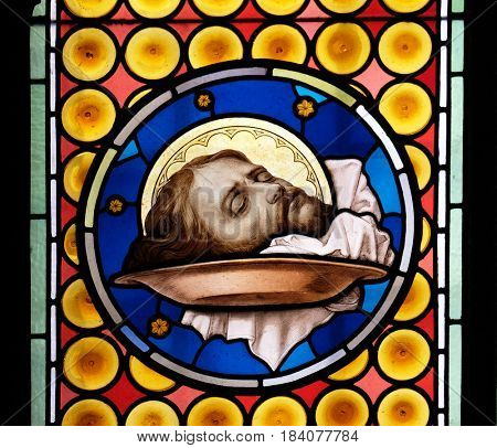 ROME, ITALY - SEPTEMBER 03: The head of Saint John the Baptist, stained glass window in Basilica of Saint Sylvester the First (San Silvestro in Capite) in Rome, Italy on September 03, 2016.