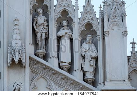 ROME, ITALY - SEPTEMBER 02: Statues of St. Victor, Francis of Assisi and Nicholas of Tolentino on the facade of Sacro Cuore del Suffragio church in Rome, Italy  on September 02, 2016.
