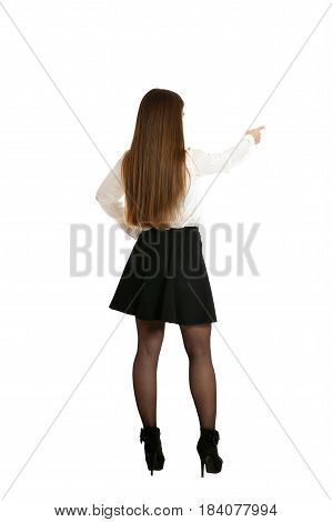 Beautiful woman in white blouse pointing , back view on white background