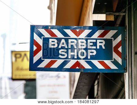 Slightly bent and slightly rusty barber shop sign.