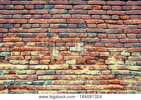Ancient, old aged brick wall. Aged photo look
