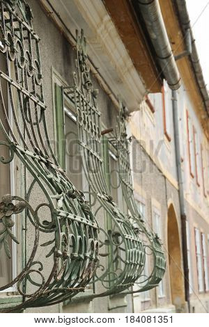 Old house with beautiful wrought iron bars on the windows. The medieval city of Sibiu, Romania