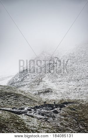 Beautiful Winter Landscape Image Around Mam Tor Countryside In Peak District England With Hikers