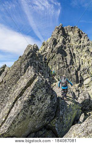 Three Mountaineers On The Ridge.