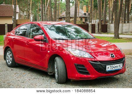 Smolensk, Russia - April 25, 2017: New Mazda 3 (Axela) parked in suburbian street of Smolensk.