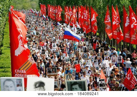 Volgograd Russia - May 9 2016: Procession of local people with photos of their relatives in Immortal Regiment on annual Victory Day on Mamaev Hill in Volgograd