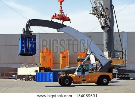 Rostock, Germany - April 20, 2017: Container loader - reach stacker in the test area of Liebherr crane building factory