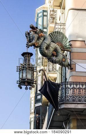 Barcelona. Chinese dragon on House of Umbrellas (Casa Bruno Cuadros) building on La Rambla. Catalonia, Spain.