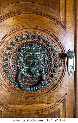 Sintra, Portugal - April 5, 2017: Vintage old door with lion door knocker Quinta da Regaleira Palace Sintra, Portugal