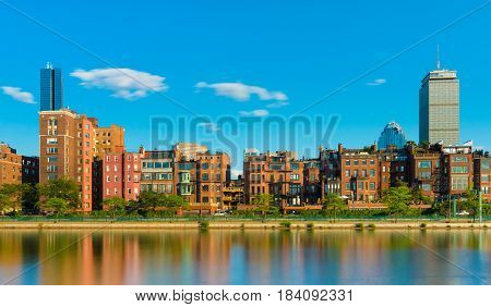 Boston USA: Old historical houses and skyscrapers buildings reflected in water of Charles River, Boston Back bay district