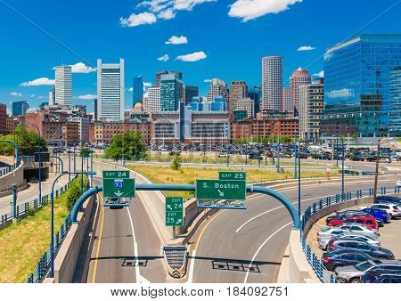 Boston - June 2016, MA, USA: Boston skyline in sunny summer day, view of skyscrapers office buildings in downtown and highway with no traffic