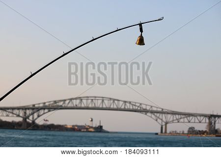 Fishing Pole in front of Blue Water Bridge