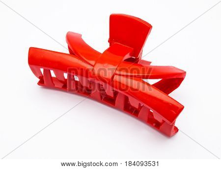 Closeup To Red Plastic Hair Clip, Isolated