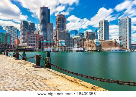 Boston cityscape in sunny day, view from harbor on downtown Massachusetts, USA
