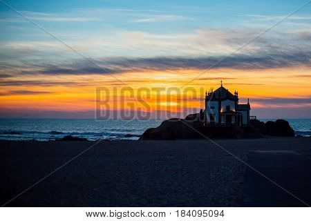 Chapel Senhor da Pedra at sunset, Miramar Beach, Porto, Portugal.