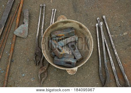 The blacksmith's tools are hammers and pincers