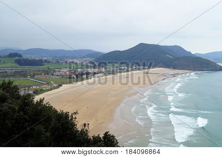 Beach and village of Berria from Mount Buciero, Santoña, Cantabria, Spain