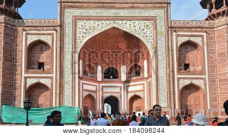 Agra, India - February 19, 2017 The four storeyed main gateway of the Taj Mahal is 100 feet high and is built in red sandstone.