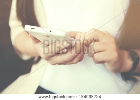 Woman relaxing on a bed using a mobile phone