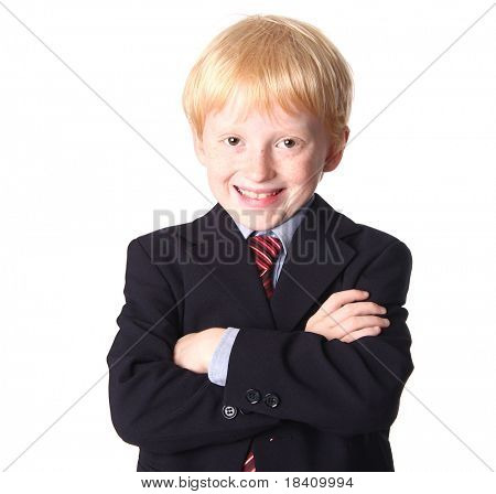 Smiling young boy dressed up