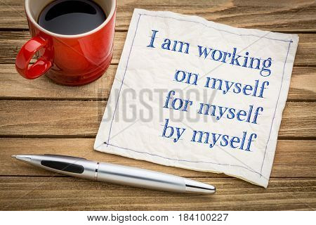 I am working on myself, for myself, by myself - handwriting on a napkin with a cup of coffee