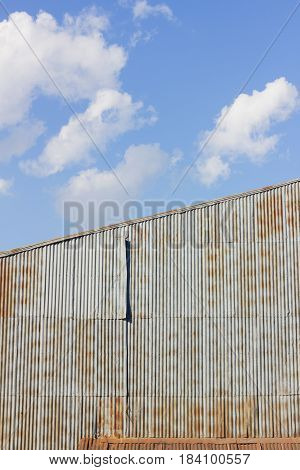 closeup house made of rusty galvanized iron in cloudy sky