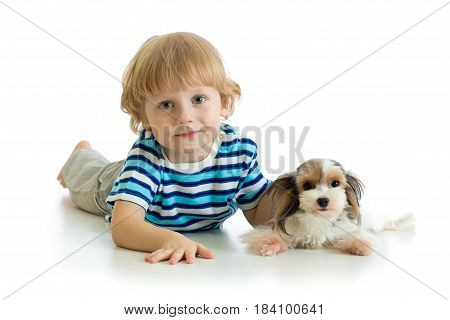 Cute child boy and puppy dog looking at camera isolated on white background