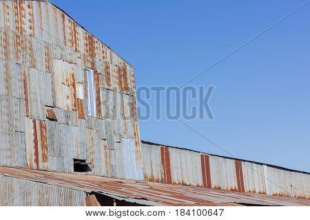 closeup old building made of rusty galvanized iron