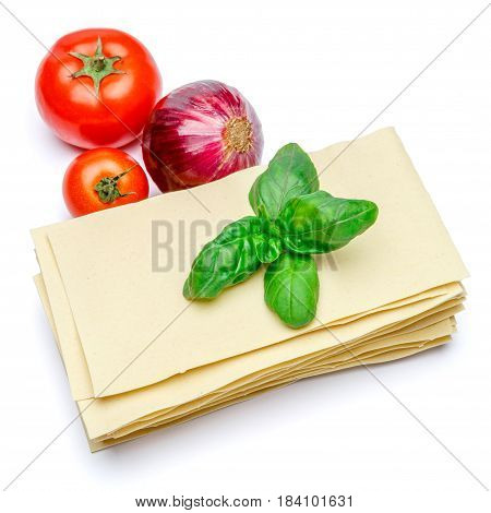 dried uncooked lasagna pasta sheets and vegetables isolated over the white background
