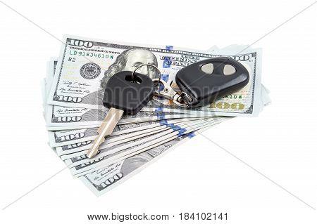 Car's keys on the money. Isolated on white.