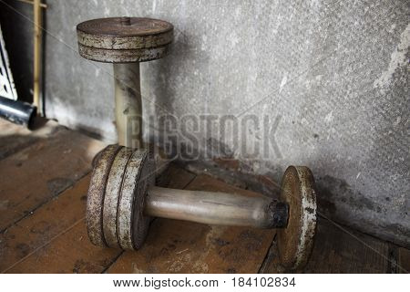Old iron dumbbells, worn and with rust from time to time