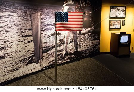 American Flag waiving on the moon next to an austonaut