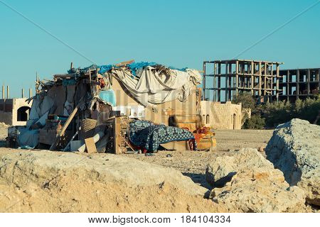 Slums and ruined house in Egypt city at sunset